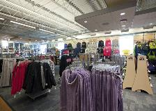 A wide angle view of the clothing area of the bookstore