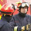 Two firefighters conversing in uniform