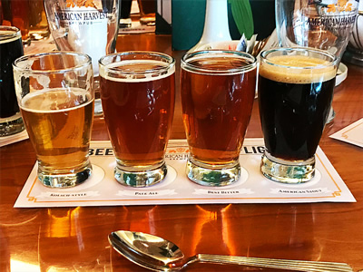 Four beers lined up on a table