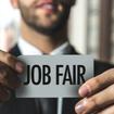 Man Holding Job Fair Sign