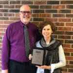 Steven L. Berg and Nancy Anter with Award