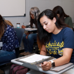 Women in blue shirt studying in classroom