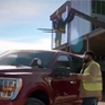 A male construction worker and Ford truck on a construction site