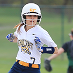 Female softball player running to base