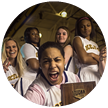 Photo of the women's basketball team celebrating a championship