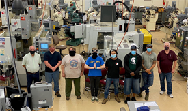 Students with masks in a CNC machinery classroom setting