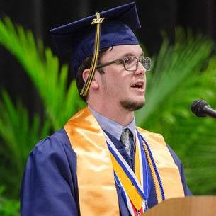 Photo of student giving commencement speech
