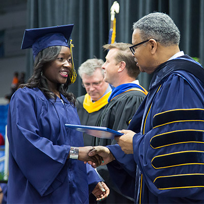 Dr. Jeffress shakes a students hand during the Commencements ceremony.