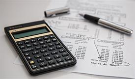 Photo of Calculator on Financial Statement