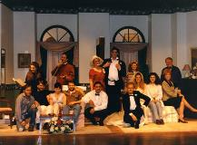 A group photo of the actors and participants in a production.