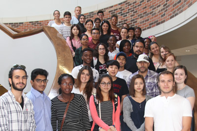 A large group photo of students posing along a staircase