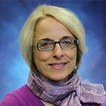 Professional headshot of Anita Suess Kaushik