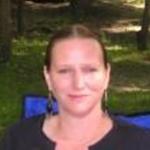 Professional headshot of Karen Schaumann-Beltran