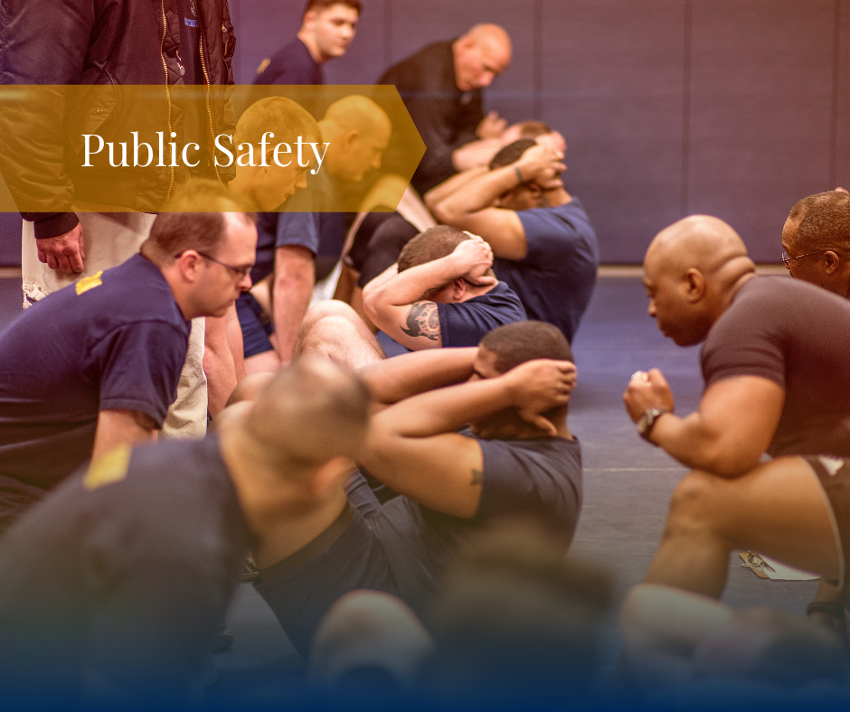 A group of police academy students doing sit ups with text that reads Public Safety
