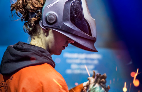 A woman welding in Schoolcraft