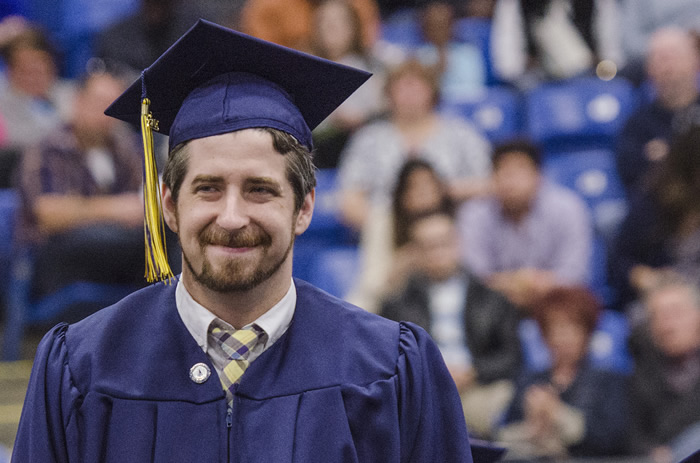 Student, Ken Damphousse, stands during commencement to be honored for receiving Schoolcraft